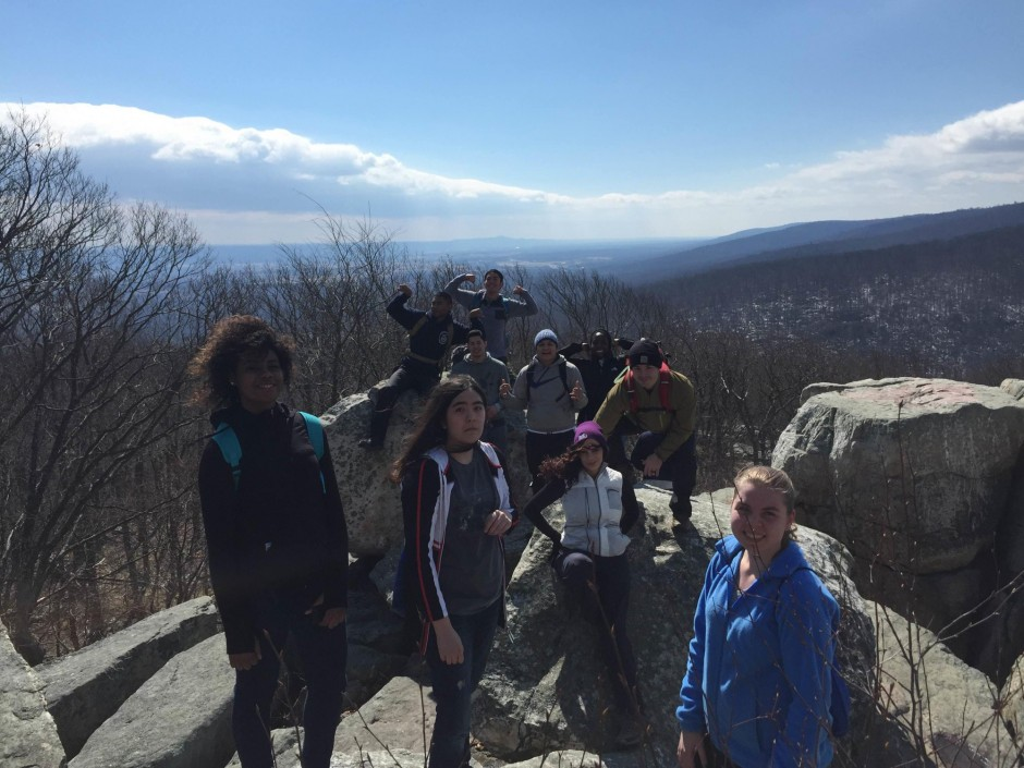 Adventure Club Members on top of Chimney Rock Catoctin. Sugarloaf can be seen directly behind vice-president, Kelvin Wo.